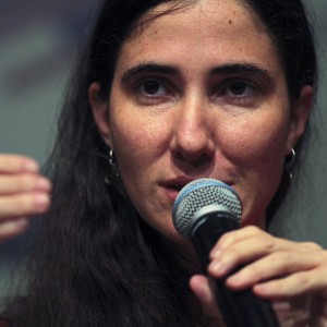 Cuba's best-known dissident, blogger Yoani Sanchez, addresses a news conference at the auditorium of the Chamber Executives of shopkeepers in Feira de Santana February 19, 2013. Sanchez is on an 80-day tour, after she was granted a passport two weeks ago under Cuba's sweeping immigration reform that went into effect this year. She has won several international prizes for blogging about life in Cuba but has been unable to collect them until now. REUTERS/Ueslei Marcelino (BRAZIL - Tags: POLITICS PROFILE)